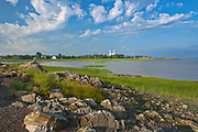 Shoreline along the Gulf of St. Lawrence with church and village<br />Saint-Roch-des-Aulnaies<br />Quebec<br />Canada