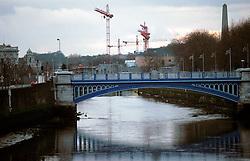 IRELAND DUBLIN MAR00 - Cranes point skywards on one of Dublin's many construction sites along the Liffey. .. jre/Photo by Jiri Rezac. . © Jiri Rezac 2000. . Tel:   +44 (0) 7050 110 417. Email: info@jirirezac.com. Web:   www.jirirezac.com