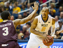 Dec 13, 2015; Morgantown, WV, USA; West Virginia Mountaineers guard Jevon Carter (2) looks to get around Louisiana Monroe Warhawks guard Marcus Washington (3) during the first half at WVU Coliseum. Mandatory Credit: Ben Queen-USA TODAY Sports