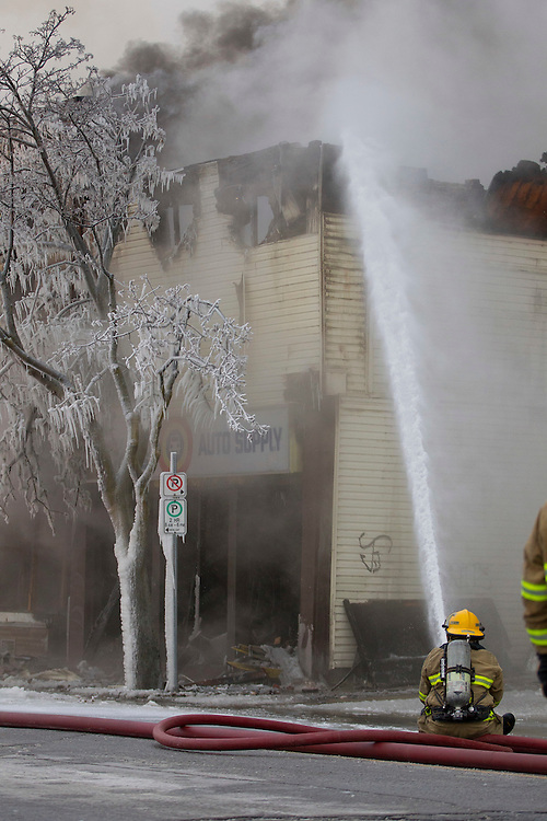 St.Thomas, ONT.; December 12,2013  -- Firefighters battle a blaze on Talbot Street in St. Thomas, Ontario December 13, 2013 which destroyed several businesses and a methadone clinic.<br /> Photo by GEOFF ROBINS