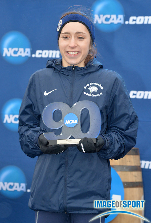 Nov 21, 2015; Louisville, KY, USA; Laura Rose Donnegan of New Hampshire poses with the NCAA Elite 90 trophy for highest grade point average among participants during the 2015 NCAA cross country championships at Tom Sawyer Park.
