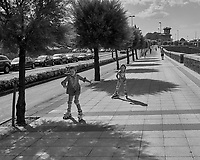 Sidewalk Skaters in Getxo Spain. Image taken with a Leica X2 camera (ISO 100, 24 mm, f/6.3, 1/1250 sec). Raw image processed with Capture One Pro, and Photoshop CC 2014