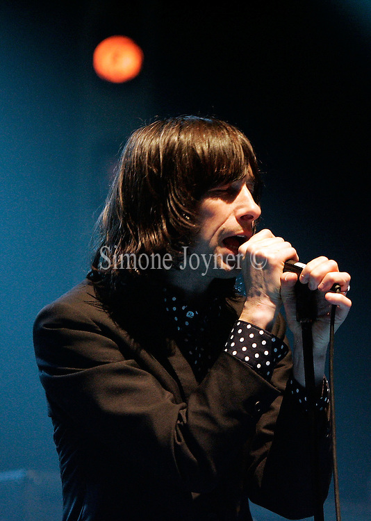 Bobby Gillespie of Primal Scream performs live on stage as part of the NME Rock 'N' Roll Riot Tour at Hammersmith Apollo on November 28, 2008 in London, England.  (Photo by Simone Joyner)
