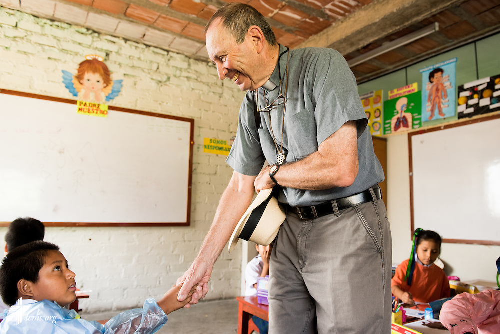 The Rev. Herb Burch, LCMS career missionary to Peru, visits with students at the Noe (Spanish for Noah) school, one of many places affected by recent landslides near Lima, Peru, on Tuesday, April 7, 2015.  LCMS Communications/Erik M. Lunsford