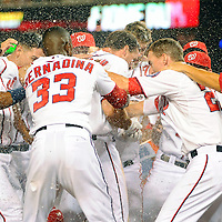 26 July 2013:  Washington Nationals third baseman Ryan Zimmerman (11) is showered at home plate after hitting the game winning walk off home run to win the game against the New York Mets at Nationals Park in Washington, D.C. where the Washington Nationals defeated the New York Mets, 2-1 in the second game of day night doubleheader.