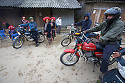 "Hilltribe villages around Sapa. Red Dzao village, tourists on Minsk motorbikes (""mules of the hills"")."