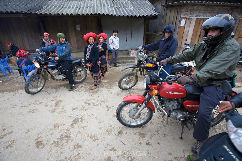 "Hilltribe villages around Sapa. Red Dzao village, tourists on Minsk motorbikes (""mules of the hills"")."