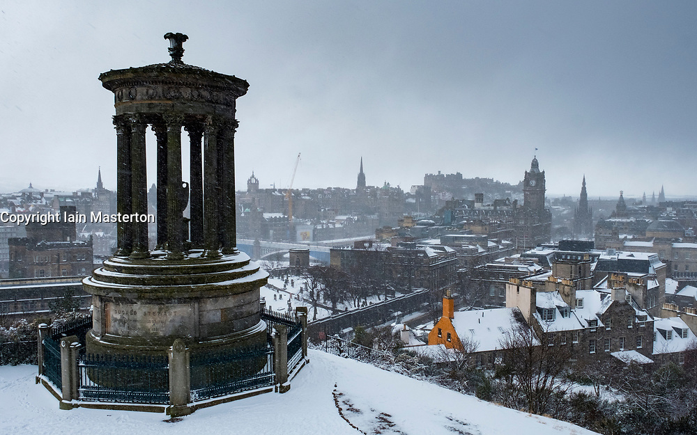 View from Calton Hill over city of Edinburgh during heavy snow falls , Scotland, United Kingdom