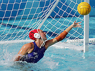Australian goalkeeper Emman Knox stretches to reach a shot on goal by  the  United States  in the bronze medal match in the Women's Water Polol at theOlympicv Aquatic Centre in Athens Thursday 26 August 2004.  The US won 6 to 5. (Photo by Patrick B. Kraemer / MAGICPBK)