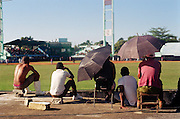 January 21, 2015 - Nueva Gerona, Cuba. La Isla fans watch the second game of a doubleheader from the roof of a concrete house behind the centerfield fence. 01/21/2015 Photograph by Joseph Swide/NYCity Photo Wire