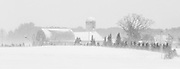 Black and white image of a farm on a blustery winter's day,near Mont Tremblant, Quebec.