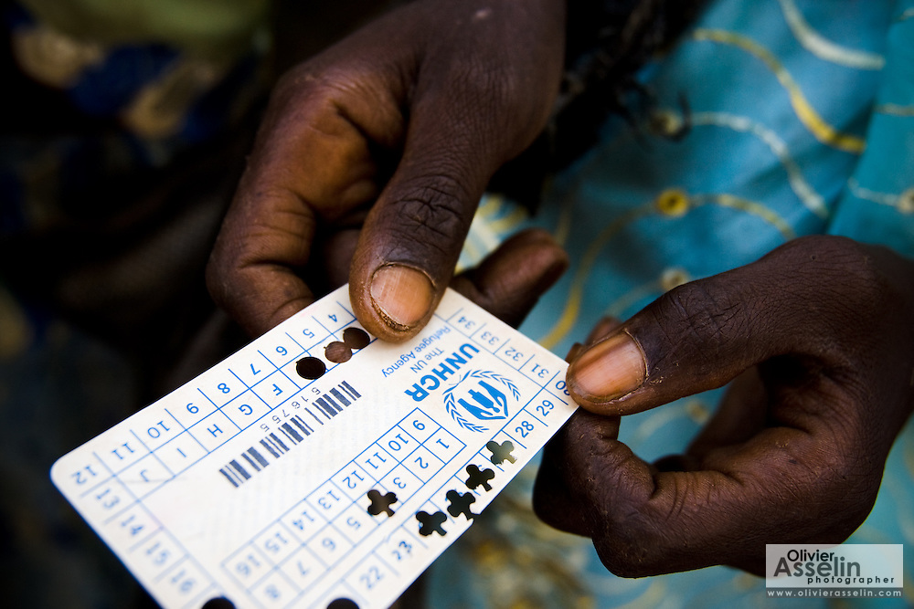 A refugee woman from Central African Republic holds a card she uses to receive food rations at the Garga Sarali integrated health center in the town of Garga Sarali, near Bertoua, Cameroon, on Tuesday September 15, 2009.