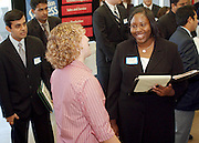 10/06/04--Tameka Foster, a senior majoring in management information systems and finance shares a laugh with Megan Wagner, recruiter from Deloitte and Touche at today's career fair in the Convocation Center.