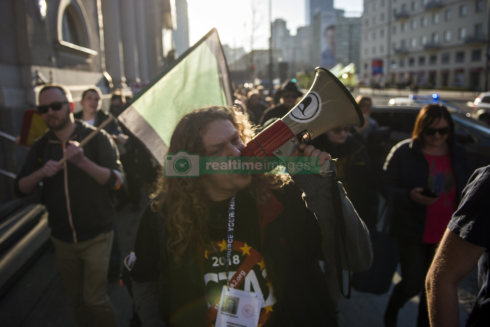 March 23, 2019 - Warsaw, Mazowieckie, Poland - A protester seen shouting slogans on a megaphone during the protest..Voting on the change of copyright in the European Union will take place in the last days of March. Therefore, on March 23, opponents of the controversial articles 11 and 13 intend to mobilize and take to the streets. The international Stop Acta 2.0 protest actions also took place in Warsaw and other numerous cities in Poland. (Credit Image: © Attila Husejnow/SOPA Images via ZUMA Wire)