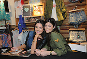 Kendall, left, and Kylie Jenner launch their exclusive Kendall & Kylie  collection during a public appearance at a PacSun store on Long Island, New York, Friday, February 8, 2013.   (Photo by Diane Bondareff/Invision for PacSun/AP Images)