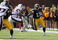 September 24, 2011: Iowa Hawkeyes wide receiver Kevonte Martin-Manley (11) tries to hold off Louisiana Monroe Warhawks safety Isaiah Newsome (25) on a reception during the first quarter of the game between the Iowa Hawkeyes and the Louisiana Monroe Warhawks at Kinnick Stadium in Iowa City, Iowa on Saturday, September 24, 2011. Iowa defeated Louisiana Monroe 45-17.