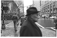 Man with hat in New York. Street photography. 1980