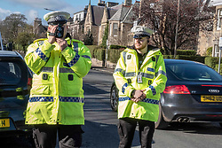 Pictured: PCs Chris Beddows (with speed gun) and Sam Ali were on warning duty today.<br />