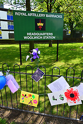Flowers and tributes left at Woolwich Barracks for Drummer Lee Rigby who was murdered near the barracks, Woolwich Barracks, Woolwich, London, Great Britain. On the afternoon of 22 May 2013, Lee Rigby, a British Army soldier in the Royal Regiment of Fusiliers, was killed by two attackers near the Royal Artillery Barracks in Woolwich in southeast London, UK, 27th May 2013. Photo by Nils Jorgensen / i-Images.