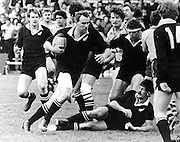 Graeme Higginson attacks against Australia in the second test of the 1982 series at Athletic Park in Wellington. All Blacks pictured, from left, are: Mark Shaw, Andy Dalton, Murray Mexted (on ground), Stu Wilson (14). 28 August 1982. Photo: PHOTOSPORT/Peter Bush