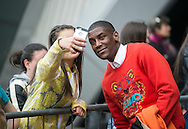 Singer Labrinth poses with fans outside the Clyde Auditorium in Glasgow