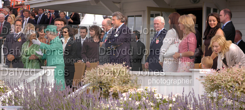 The Queen, Bianca Jagger, James Blunt, Arnaud Bamberger, Angelica Huston, Sabrina Guinness,  Cate Blanchett and her baby son Roman Upton. Cartier International Day at Guards Polo Club, Windsor Great Park. July 24, 2005. ONE TIME USE ONLY - DO NOT ARCHIVE  © Copyright Photograph by Dafydd Jones 66 Stockwell Park Rd. London SW9 0DA Tel 020 7733 0108 www.dafjones.com