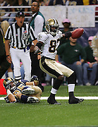 ST. LOUIS - SEPTEMBER 23:  Wide receiver Donte' Stallworth #83 of the New Orleans Saints celebrates after catching an 11 yard touchdown pass against safety Mike Furrey #25 and the St. Louis Rams at the Edward Jones Dome on September 23, 2005 in St. Louis, Missouri. The Rams defeated the Saints 28-17. ©Paul Anthony Spinelli *** Local Caption *** Donte' Stallworth;Mike Furrey