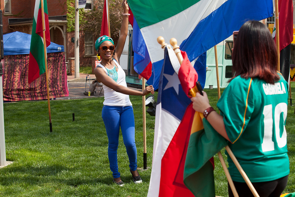 Kumba Gborie poses for a photo with a flag on College Green during the International Street Fair on Saturday April 15, 2017. Photo by Kaitlin Owens