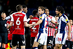 Craig Dawson of West Bromwich Albion tries to separate Ahmed Hegazy of West Bromwich Albion and Chris Mepham of Brentford after the pair square up to each other - Mandatory by-line: Robbie Stephenson/JMP - 03/12/2018 - FOOTBALL - The Hawthorns - West Bromwich, England - West Bromwich Albion v Brentford - Sky Bet Championship