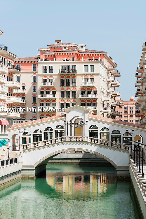 View of new Qanat Quartier residential property development with reproduction Italian styled architecture and canals at The Pearl Doha Qatar