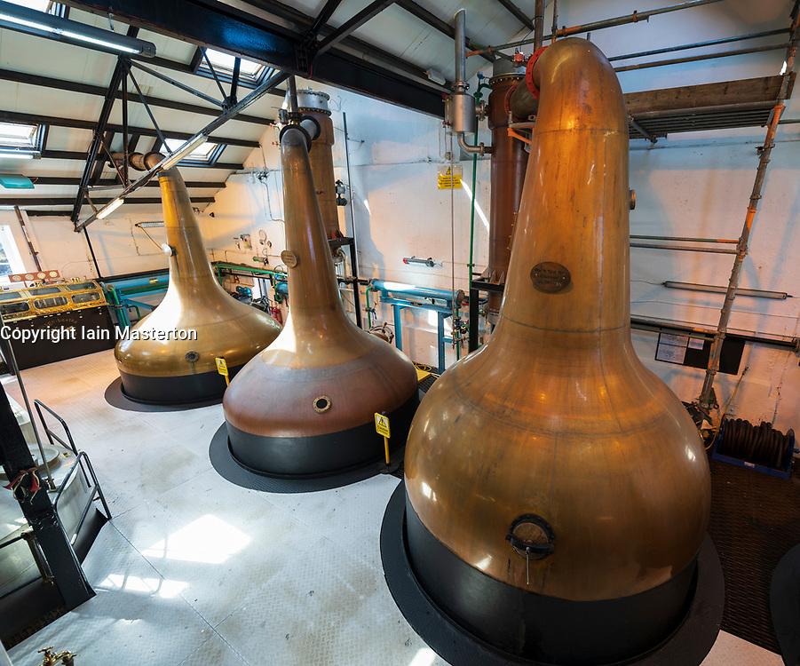 Stills inside still room Room at Bowmore Distillery on island of Islay in Inner Hebrides of Scotland, UK
