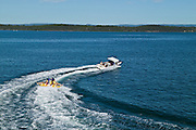 Teenagers being towed behind a speedboat on Lake Macquarie, East Coast Australia