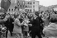 1960.Marseille,<br /> A friendly crowd of French communists<br /> breaks through security causing major<br /> panic with Khrushchev's security men<br /> as they were not prepared for a joyous outpouring such as this. They rushed Khruschev in the first car they could find and was send off. <br /> NOTE: The Russian journalists and photographers who were with us, turned around and acted as temporary bodyguards,a very unusual <br /> happening.picture 2.<br /> <br /> <br /> 1960. Marseille, France<br /> Une foule amicale des communistes fran&ccedil;ais perce la s&eacute;curit&eacute; causant une<br /> panique chez les hommes de la s&eacute;curit&eacute; de Khrouchtchev, mal pr&eacute;par&eacute;s pour une effusion de joie comme celle-ci . Ils ont pr&eacute;cipit&eacute;s Khruschev dans la premi&egrave;re voiture qu'ils ont pu trouver sont partis. <br /> NOTE : Les journalistes russes et les photographes qui &eacute;taient avec nous , se sont retournes et ont agis comme gardes du corps temporaires, une fonction tr&egrave;s inhabituel pour eux.