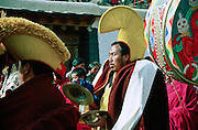 Tibetan monks of the Gelukpa order (Yellow Hats) are concentrating while recitating mantras and playing ritual drums at the end of Cham dances (dances of spirits), during the ceremonies of the Great Prayer (Monlam Chenmo). Labrang Monastery, Xiahe, China, 03 March 2007.