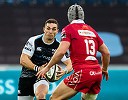 George North of Ospreys lines up Jonathan Davies of Scarlets<br /> <br /> Photographer Simon King/Replay Images<br /> <br /> Guinness PRO14 Round 11 - Ospreys v Scarlets - Saturday 22nd December 2018 - Liberty Stadium - Swansea<br /> <br /> World Copyright © Replay Images . All rights reserved. info@replayimages.co.uk - http://replayimages.co.uk