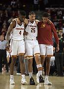 Feb 15, 2018; Los Angeles, CA, USA; Southern California Trojans forward Bennie Boatwright (25) is assisted by teammates Chimezie Metu (4) andHarrison Henderson after suffering a knee injury in the second half during an NCAA basketball game at Galen Center. USC defeated Oregon 72-70.