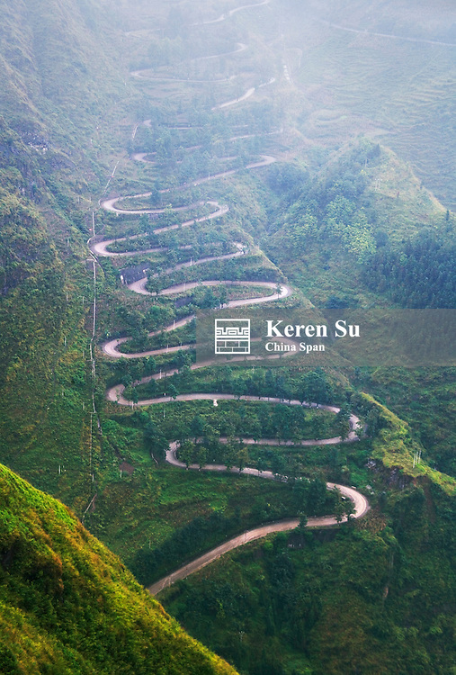 24-bend on China-Myanmar Road in the mountain in mist, Guizhou, China