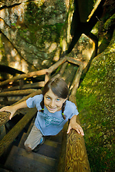 A young girl climbs stairs at Lost River Gorge in New Hampshire's White Mountains. North Woodstock.