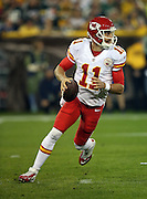 Kansas City Chiefs quarterback Alex Smith (11) rolls out on a keeper on a first quarter drive during the 2015 NFL week 3 regular season football game against the Green Bay Packers on Monday, Sept. 28, 2015 in Green Bay, Wis. The Packers won the game 38-28. (©Paul Anthony Spinelli)
