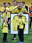 Ben Sigmund of the Phoenix holds a Phoenix shirt with his children after his last game for the Phoenix during the A-League - Wellington Phoenix v Western Sydney football match at Westpac Stadium in Wellington on Sunday the 10 April 2016. Copyright Photo by Marty Melville / www.Photosport.nz