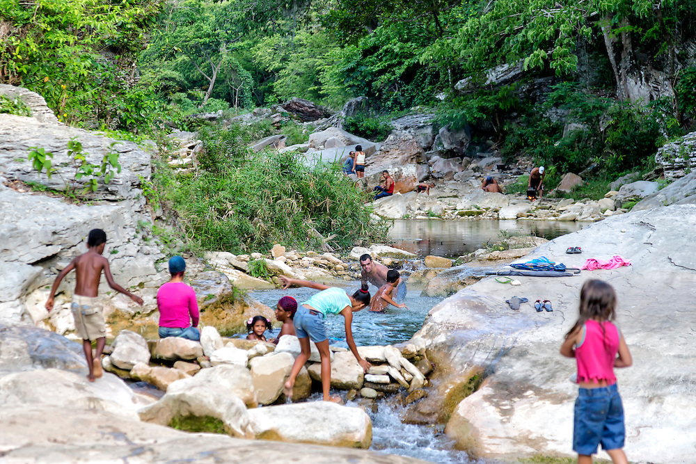 Diving and swimming at the river in Carco Redondo, Granma, Cuba.