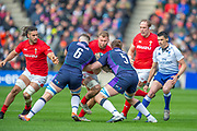 Ross Moriarty (#8) of Wales attempts to break through between Magnus Bradbury (#6) of Scotland and Jonny Gray (#5) of Scotland during the Guinness Six Nations match between Scotland and Wales at BT Murrayfield Stadium, Edinburgh, Scotland on 9 March 2019.
