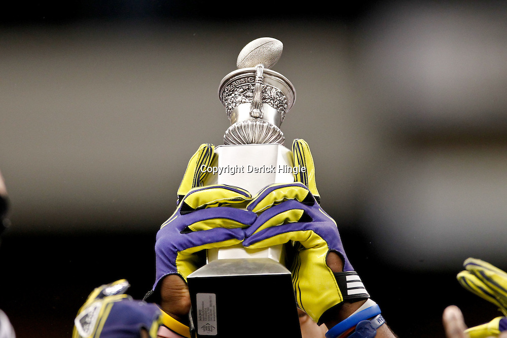 January 3, 2012; New Orleans, LA, USA; Michigan Wolverines players hold up the top of the Sugar Bowl trophy following an overtime win over the Virginia Tech Hokies in the Sugar Bowl at the Mercedes-Benz Superdome. Michigan defeated Virginia 23-20 in overtime. Mandatory Credit: Derick E. Hingle-US PRESSWIRE