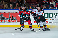 KELOWNA, CANADA - NOVEMBER 25: James Hilsendager #2 of the Kelowna Rockets is checked by Gary Haden #17 of the Medicine Hat Tigers on November 25, 2017 at Prospera Place in Kelowna, British Columbia, Canada.  (Photo by Marissa Baecker/Shoot the Breeze)  *** Local Caption ***