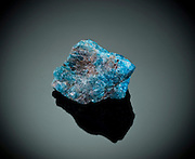 Cutout of a blue apatite gemstone on black background