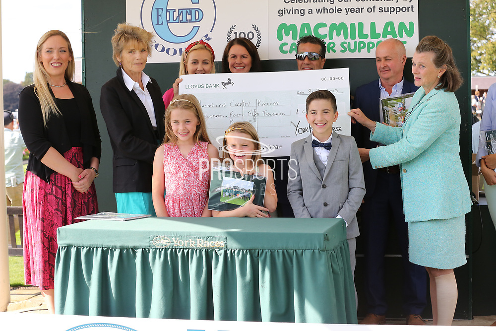 The 2019 Macmillan Riders were presented with their momento after taking part in the race earlier this year and raising £645,000 for the Macmillan Charity  during the Family Race Day held at York Racecourse, York, United Kingdom on 8 September 2019.