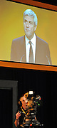 © Licensed to London News Pictures. 20/09/2011. BIRMINGHAM, UK.  A television camera and projection screen show Chris Huhne's speech on the climate at the Liberal Democrat Conference at the Birmingham ICC today (20 Sept 2011): Stephen Simpson/LNP . Photo credit : Stephen Simpson/LNP