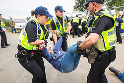 © Licensed to London News Pictures. 20/09/2017. Kirby Misperton UK. A woman is removed by police from the entrance of the Kirby Misperton KM8 fracking site this morning as a second day of protests have started. It is thought that equipment to erect noise barriers is being bought in. Third Energy was granted planning permission last year to frack the site but has not yet received final consent to begin fracking, but expects to start before the end of the year. are Photo credit: Andrew McCaren/LNP