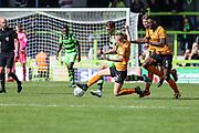 Forest Green Rovers Christian Doidge(9) is tackled by Barnet's Jack Taylor(12) during the EFL Sky Bet League 2 match between Forest Green Rovers and Barnet at the New Lawn, Forest Green, United Kingdom on 5 August 2017. Photo by Shane Healey.