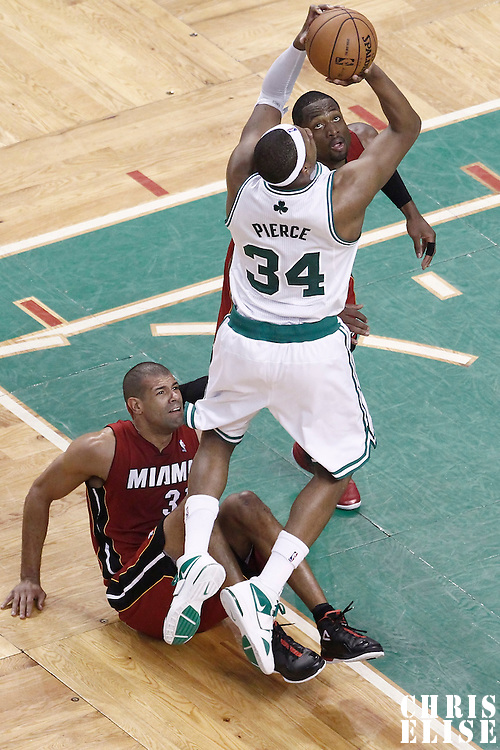07 June 2012: Boston Celtics small forward Paul Pierce (34) takes a jumpshot over Miami Heat shooting guard Dwyane Wade (3) and Miami Heat small forward Shane Battier (31) during the Miami Heat 98-79 victory over the Boston Celtics, in Game 6 of the Eastern Conference Finals playoff series, at the TD Banknorth Garden, Boston, Massachusetts, USA.